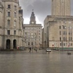 Liver Building in the rain seen between other buildings