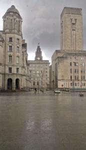 Liver Building in the rain seen between other buildings